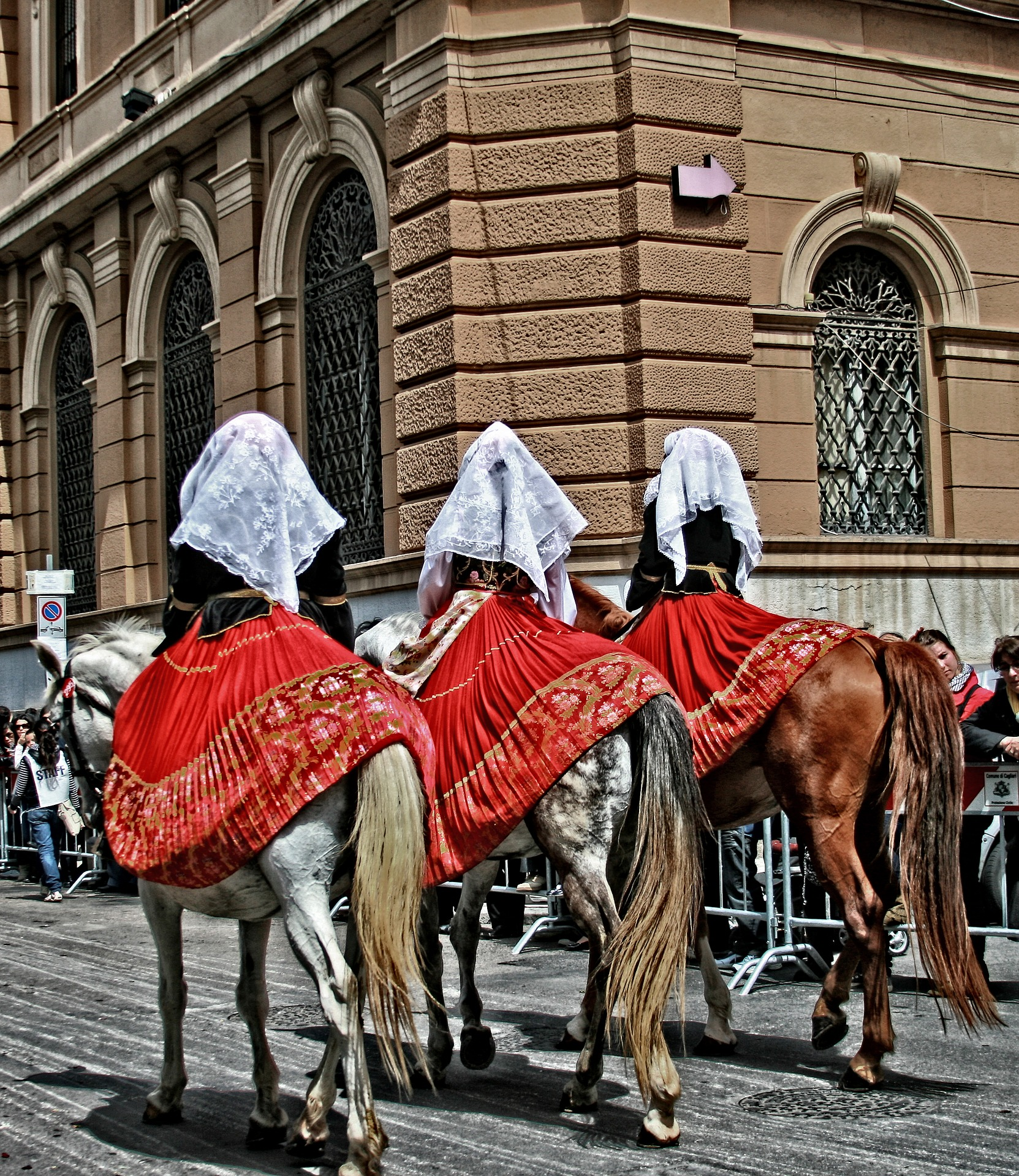 three horses at a festival in Sardinia.