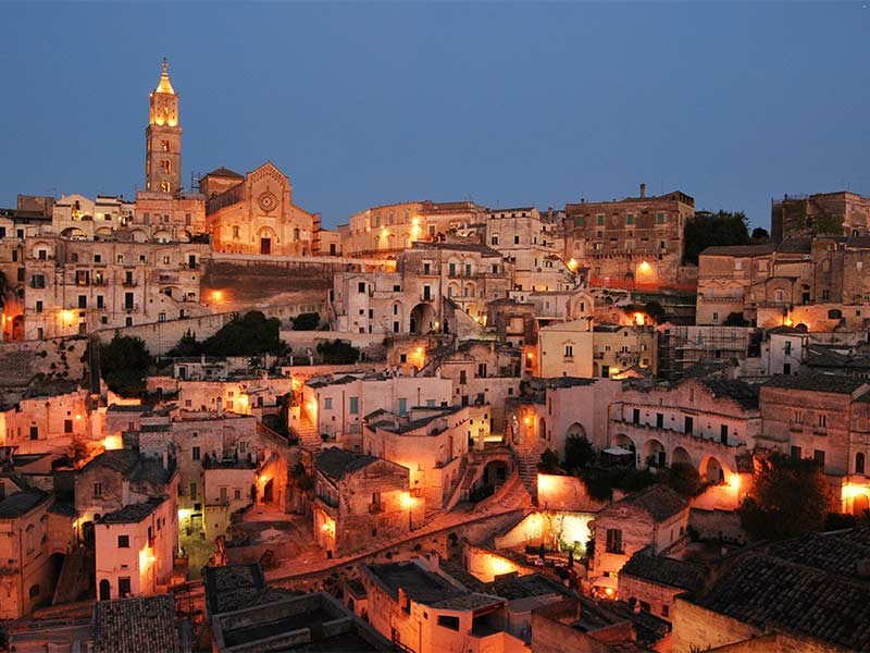 Matera at sunset, ancient town near our villas in Puglia | Essential Italy
