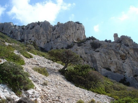 Views over Tiscali ancient town scenic hikes near our Sardinia villas Essential Italy
