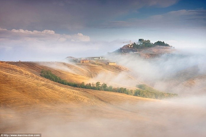 Hills of Tuscany shrouded in mist photos Puglia luxury apartments Essential Italy