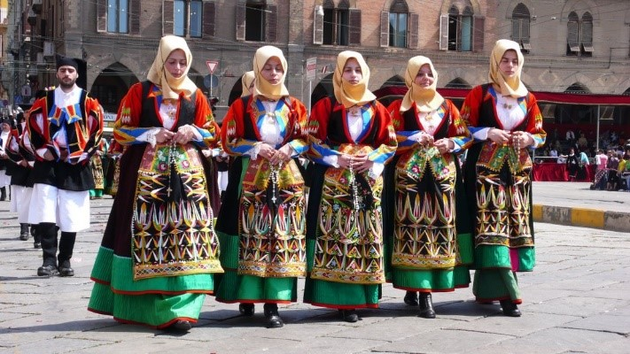 Girls in traditional costume Festival Sant'Efisio Cagliari Sardinia Essential Italy