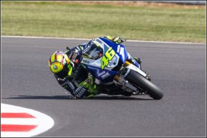 Valentino Rossi cornering with sparks flying from elbow – Essential Italy Tuscany Villas