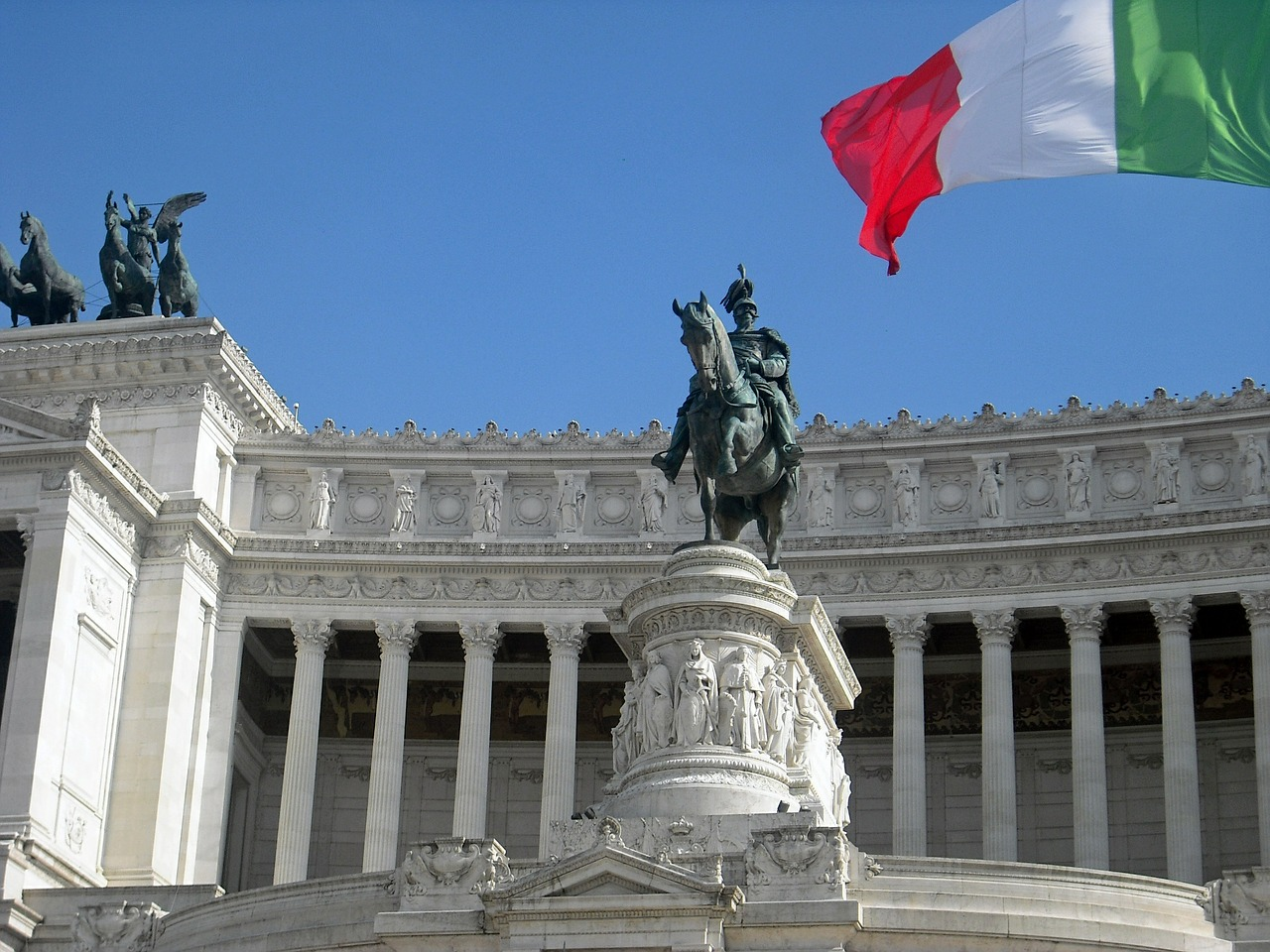 statues and the italian flag in Rome