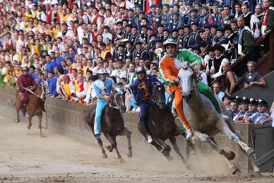 Il Palio Siena horse race taking place near our villas in Tuscany Italy