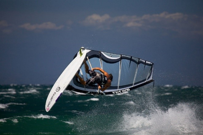 Windsurfing near our luxury villas to rent in Italy