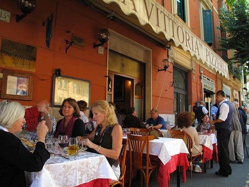 Dining out in Italy at a trattoria restaurant on your luxury holidays