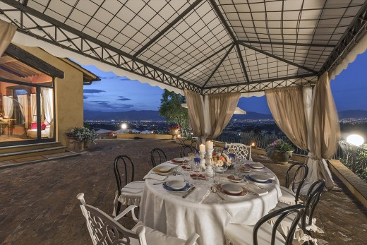 get together for a family meal under the stars in the villas in Italy