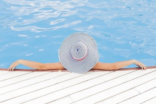 woman relaxing in a pool at our luxury villas in Puglia