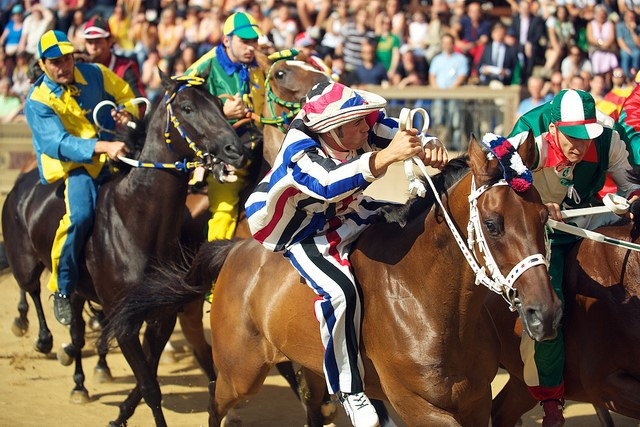Palio in Siena held in the piazza del campo you can visit on your Italian holidays