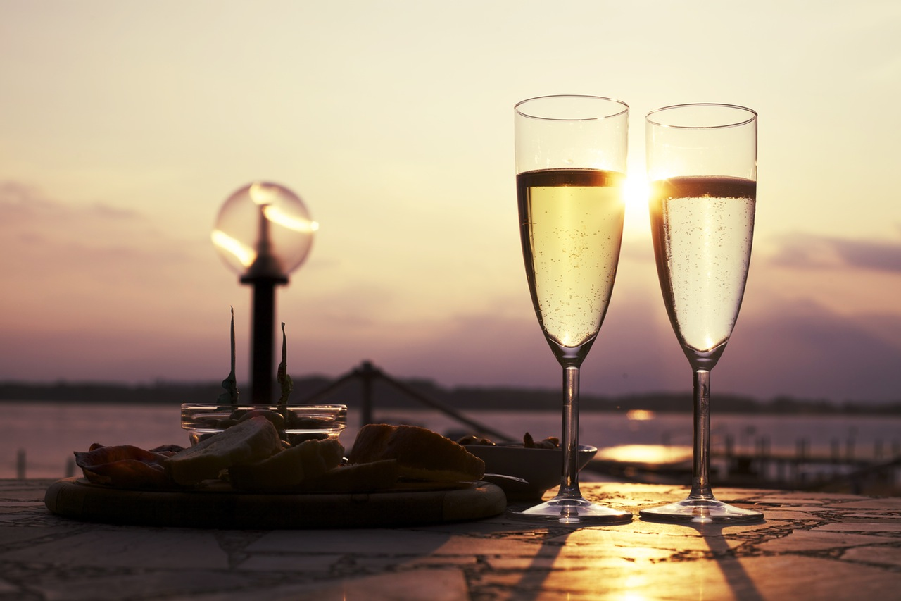 get romantic with champagne for tea by the water at the family friendly villas in Italy.