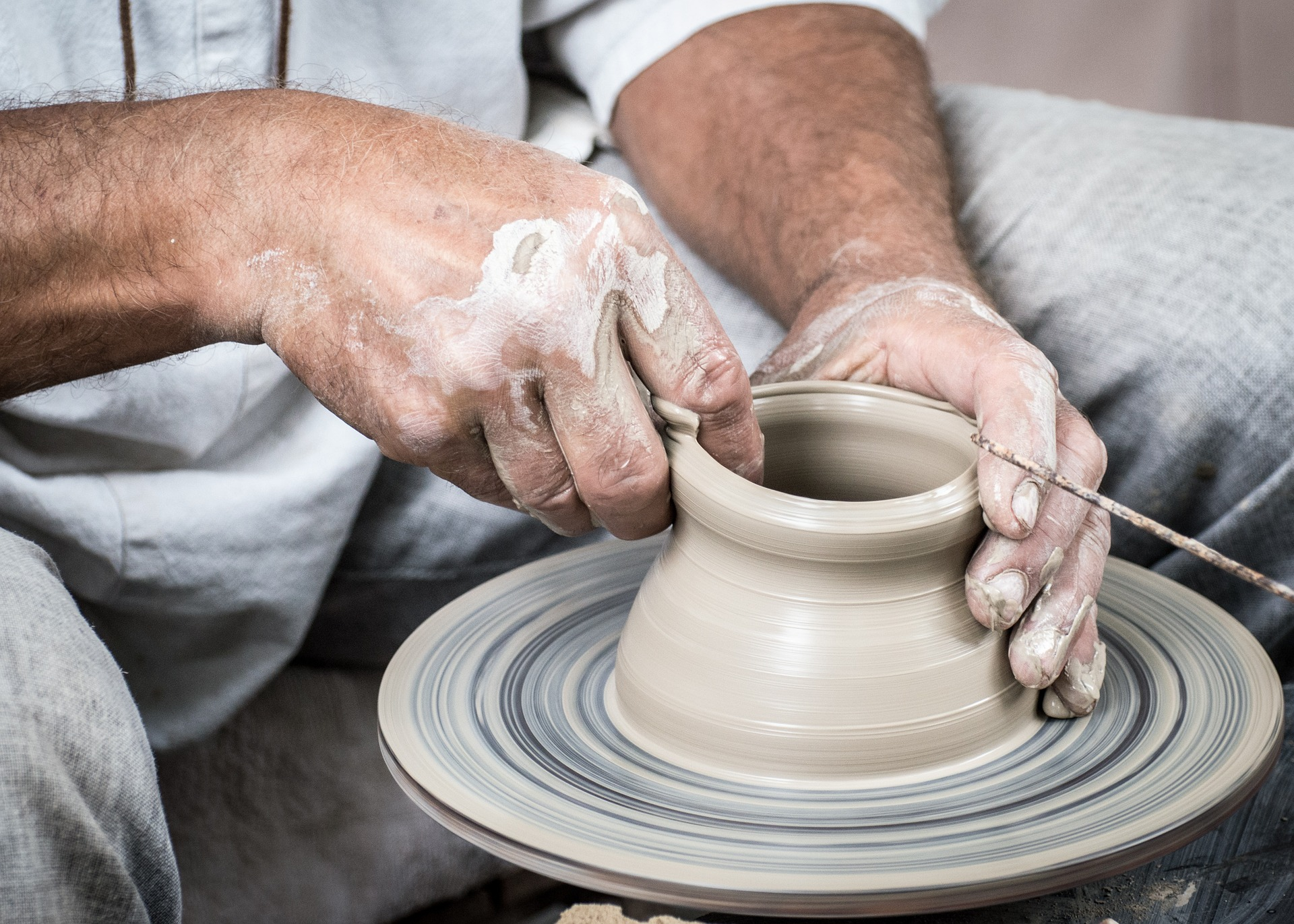 potter throwing on a potters wheel