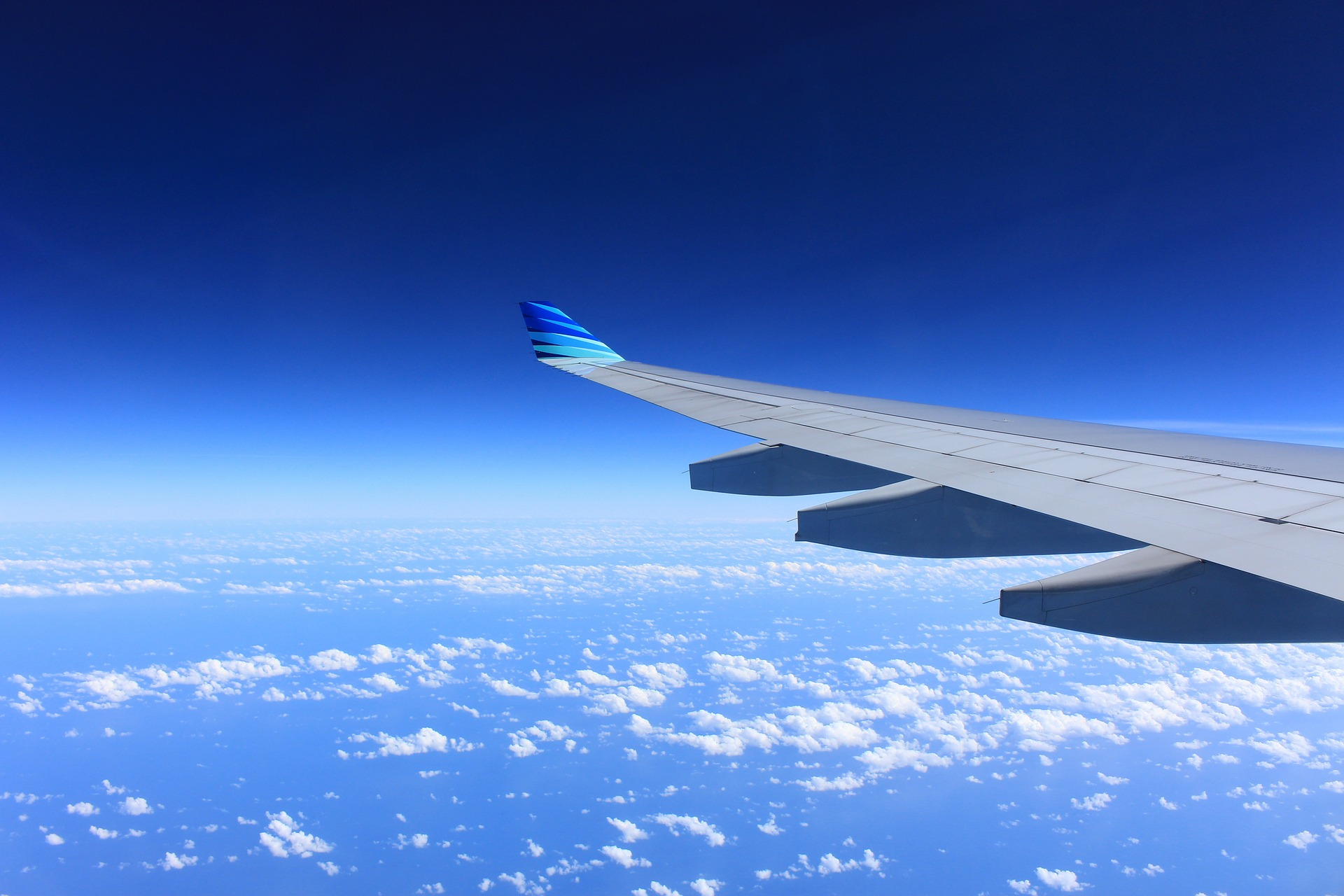 aeroplane wing in blue sky