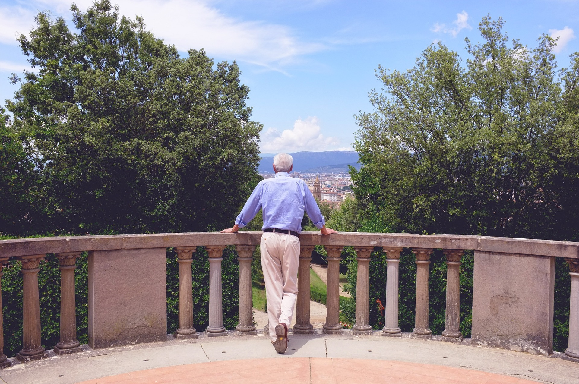 man in the Boboli gardens overlooking Florence.