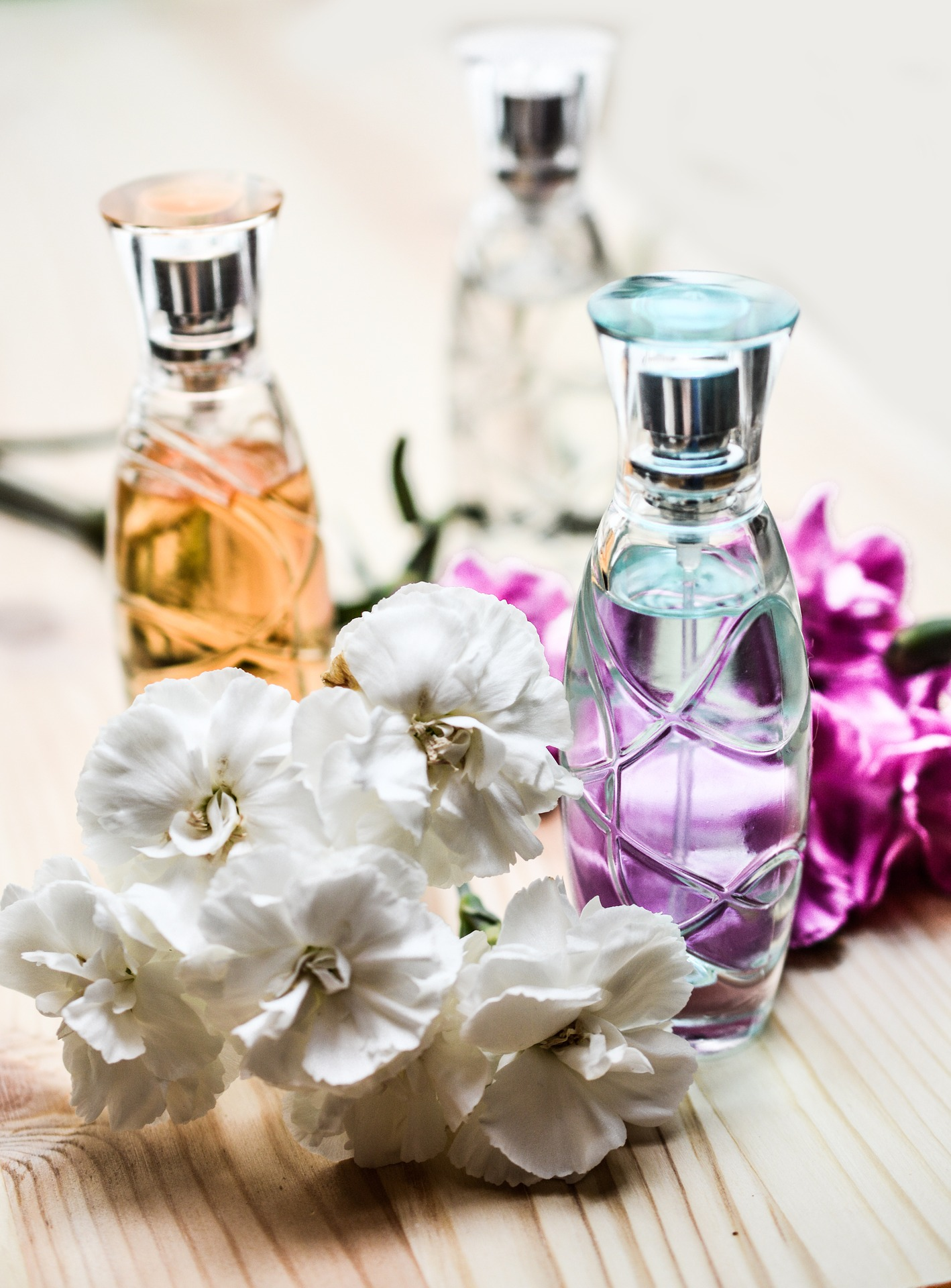 perfume in bottles and flowers