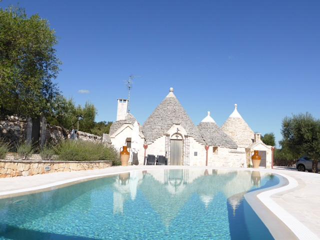 Trullo bianco villa in Puglia with a pool.