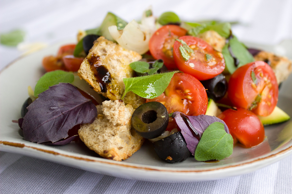 Authentic Italian tomatoes, olives and salad.