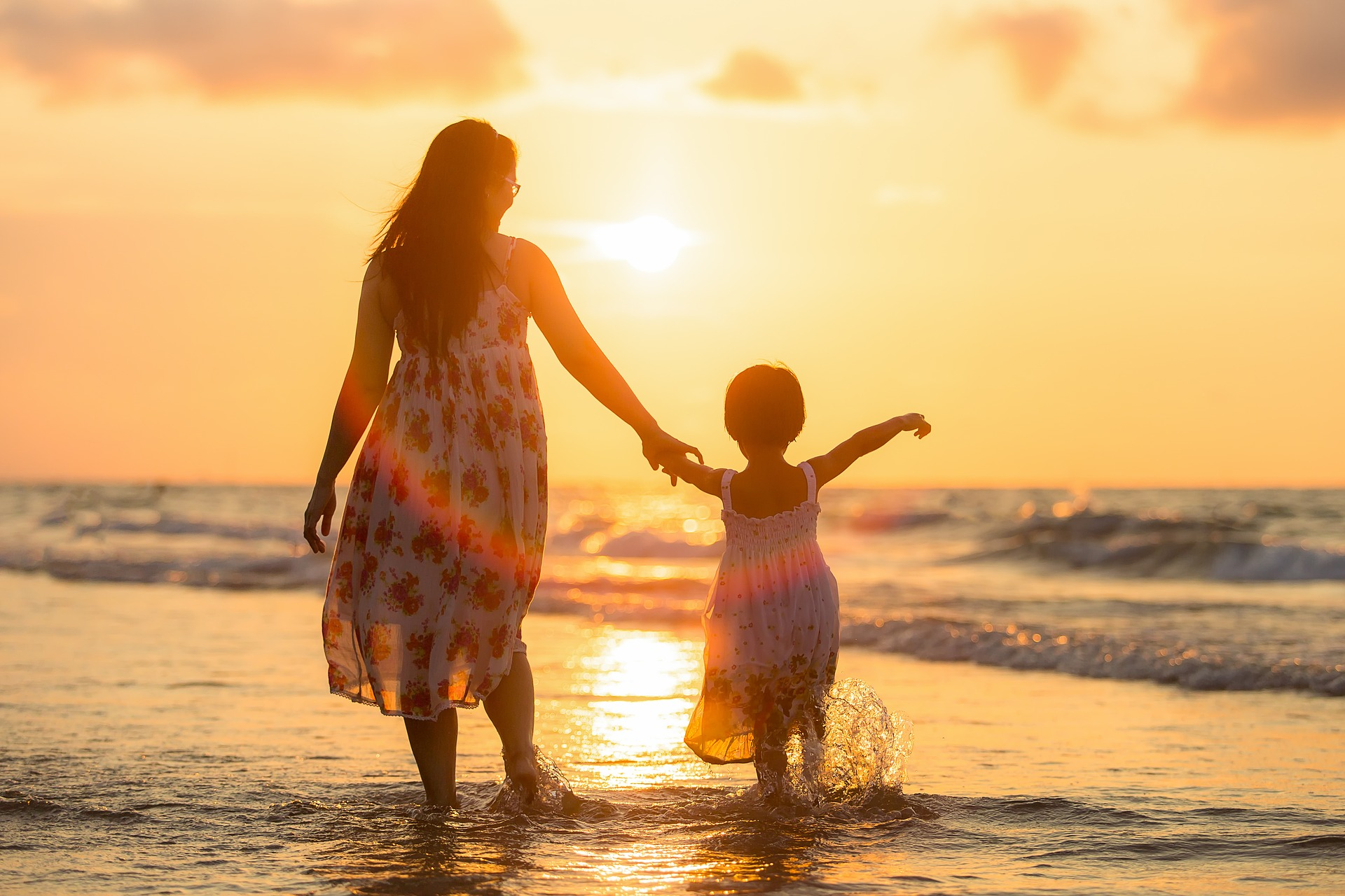A mother and daughter on the beach