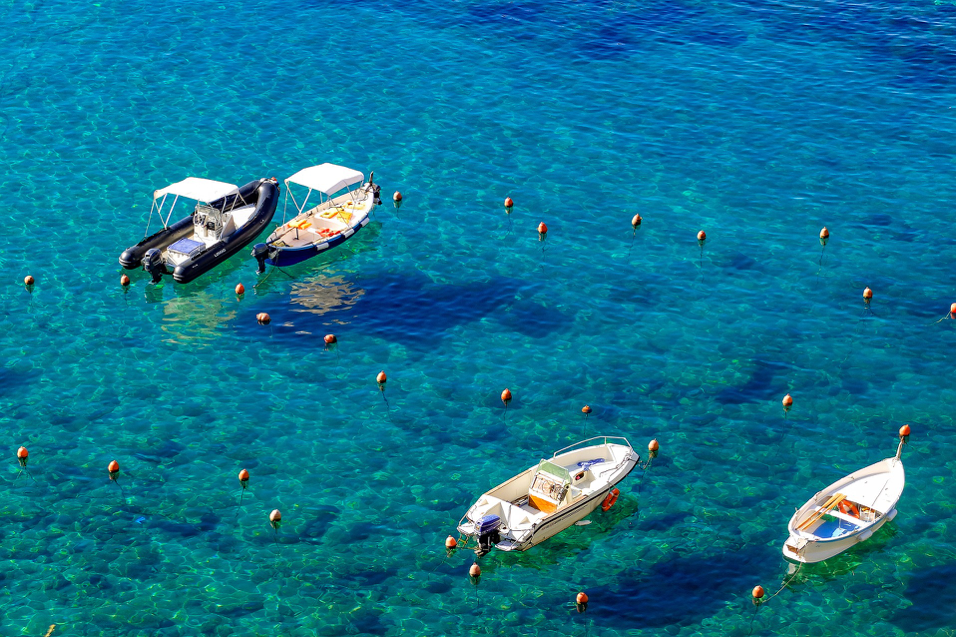 Boats bobbing in the turquoise water of Sardinia's Emerald Coast