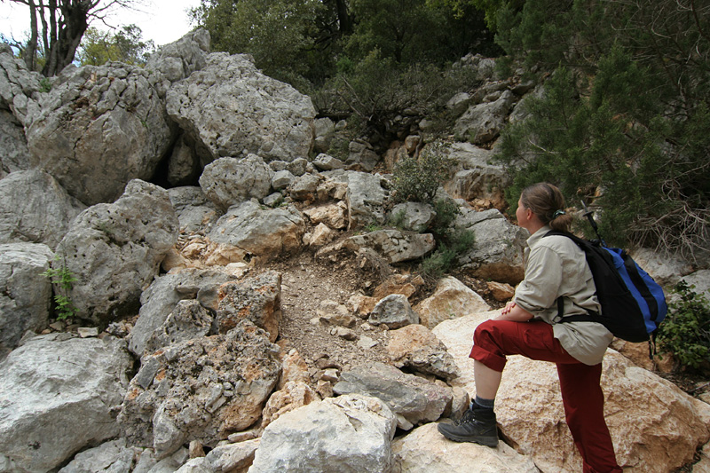 A woman hiking to Tiscali in Sardinia