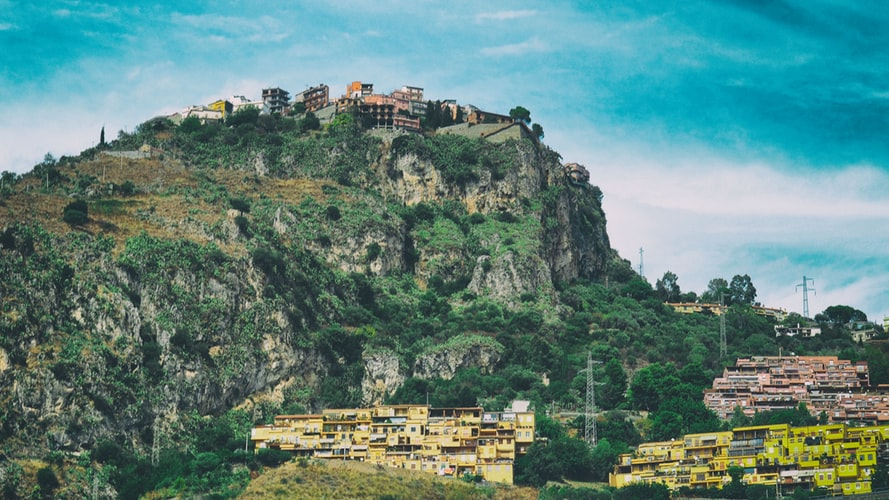 The Sicilian village of Castelmola with colourful buildings on a mountain