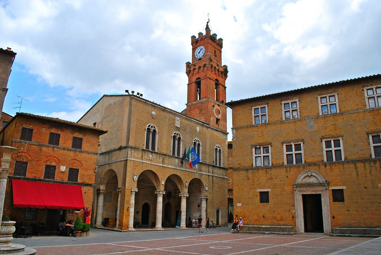 One of Pienza's many ancient squares with a clock tower in the far corner