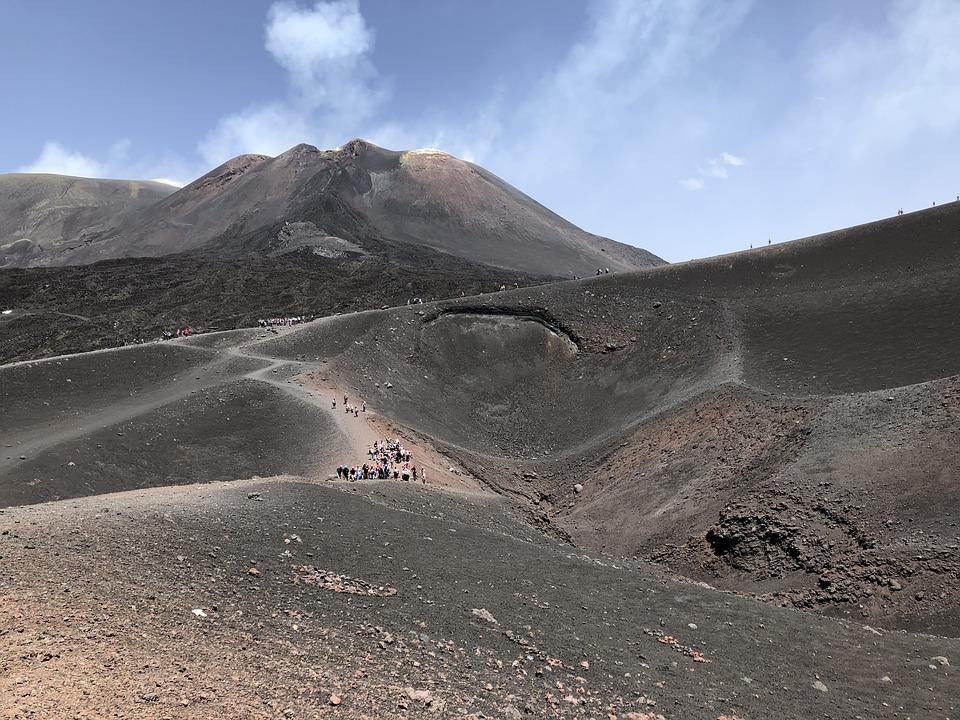 Crowds walking around Mount Etna, Italy