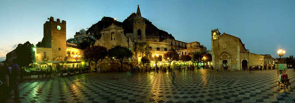 A panoramic shot of the plaza in Taormina, Sicily, at night