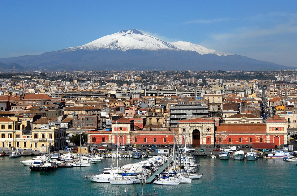 Catania from the coast on a sunny day with Mount Etna in the background
