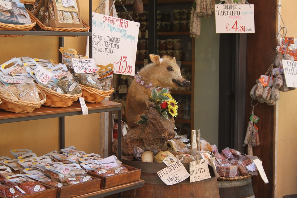 An Umbria storefront with a pig and meats