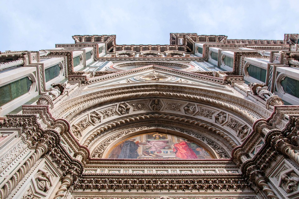 A view from the ground up of artwork on the Duomo in Florence