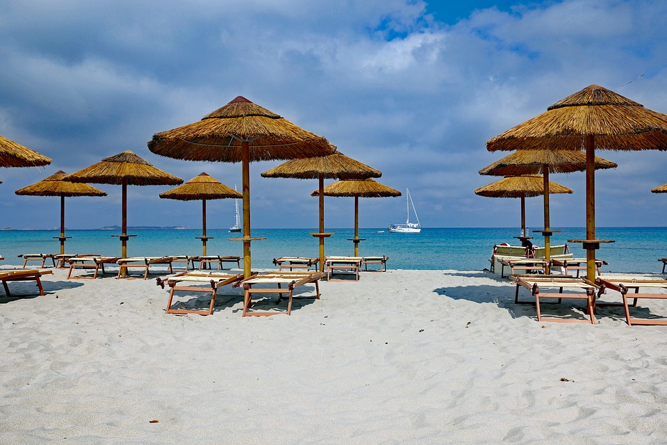 Parasols and sun-loungers on a beach in Sardinia
