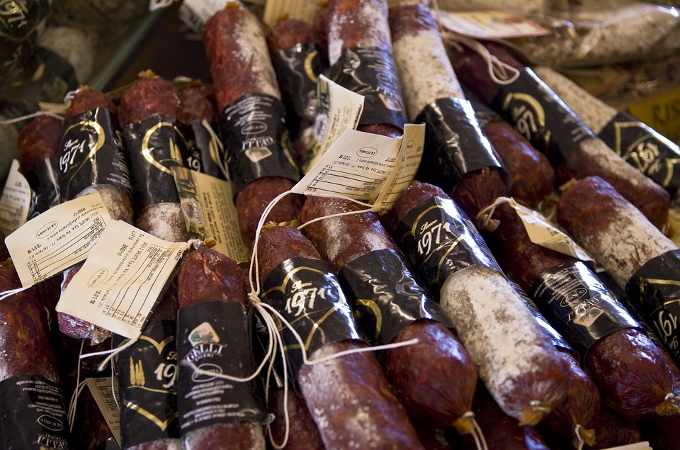 Rolls of salami being sold in Tuscany