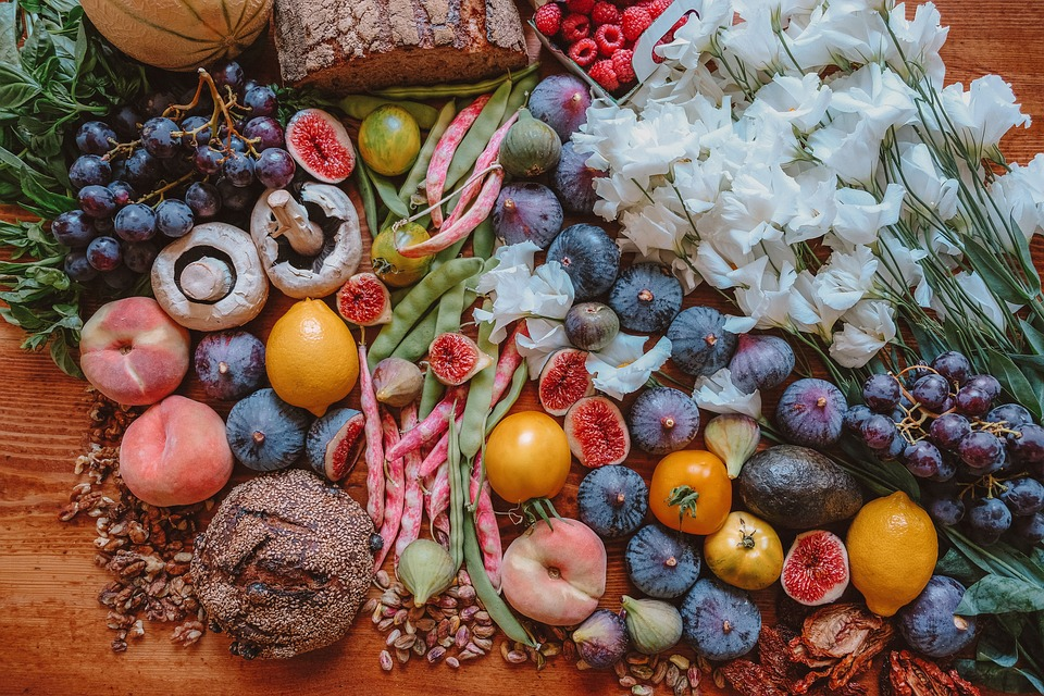A selection of fruits and vegetables from Tuscany alongside traditional Tuscan bread