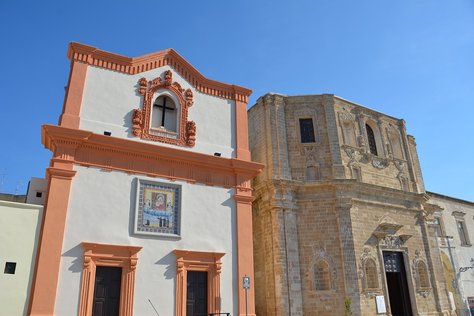 Colourful religious buildings in Gallipoli, Puglia during summer