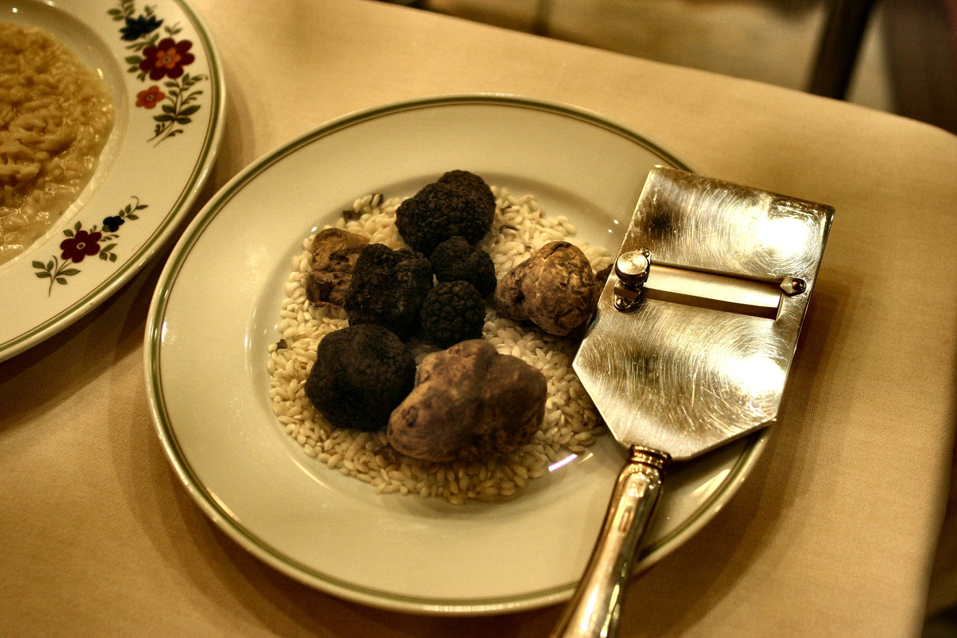 White and black truffles on a dish being served in a restaurant in Italy