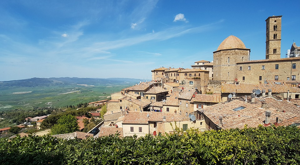 The town of Volterra in Tuscany on a sunny day with a view of the countryside