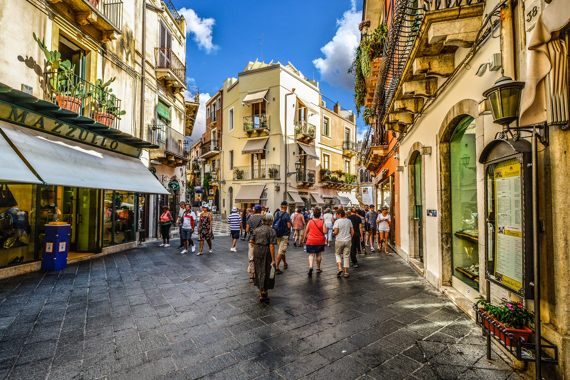 People shopping in Taormina in Sicily, Italy
