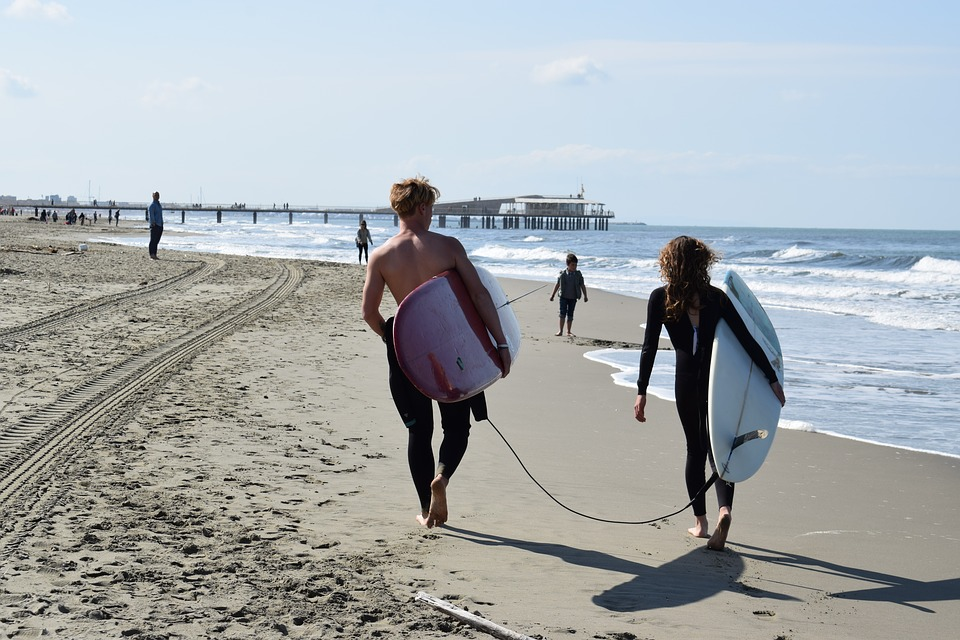 Surfers on a beach near Versilia, Tuscany