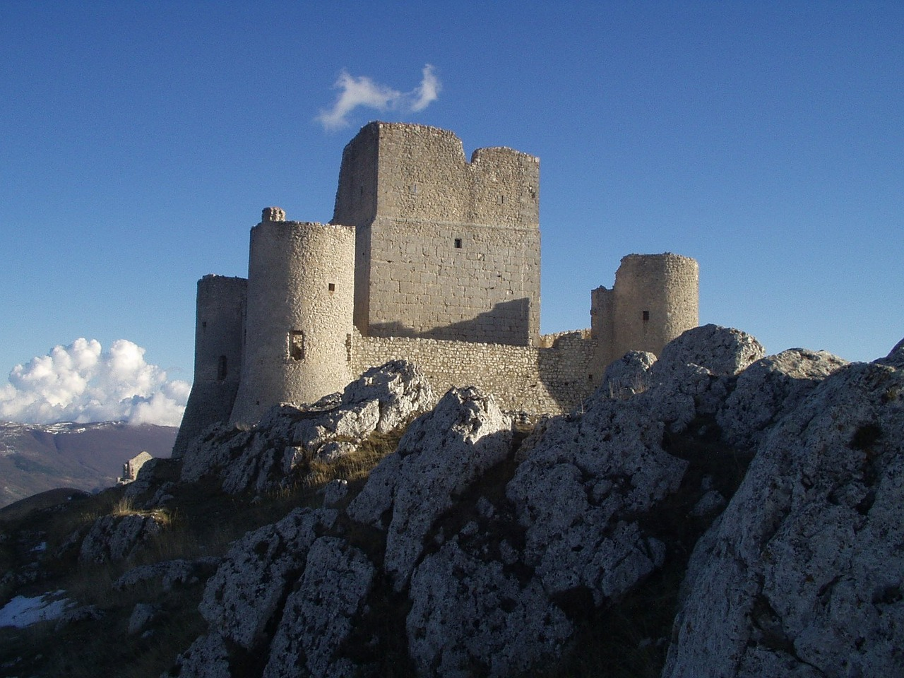 Castle with sunny blue sky in background.