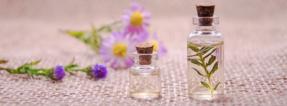 botanical perfume bottles and flowers