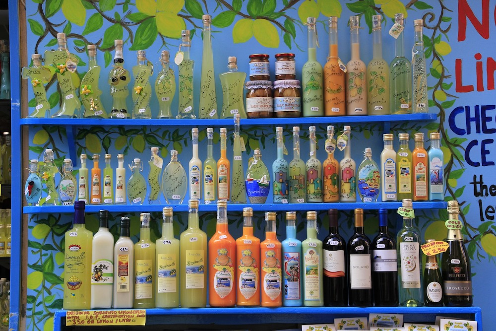 bottles of yellow limoncello on shelves