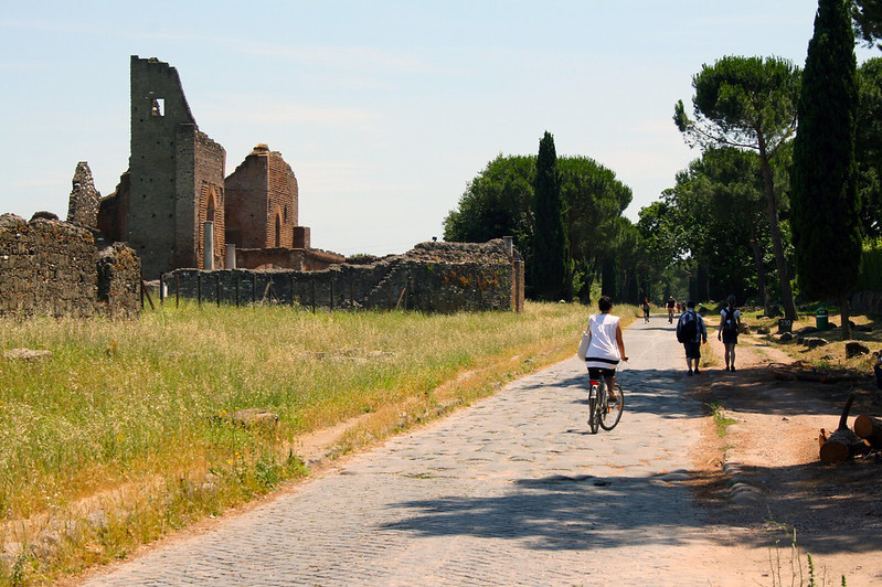 The Via Appia road and some ruins.