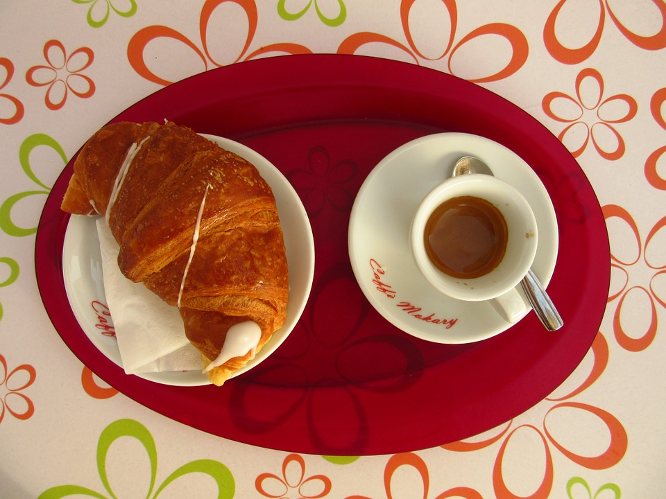 A croissant and coffee for breakfast in Italy