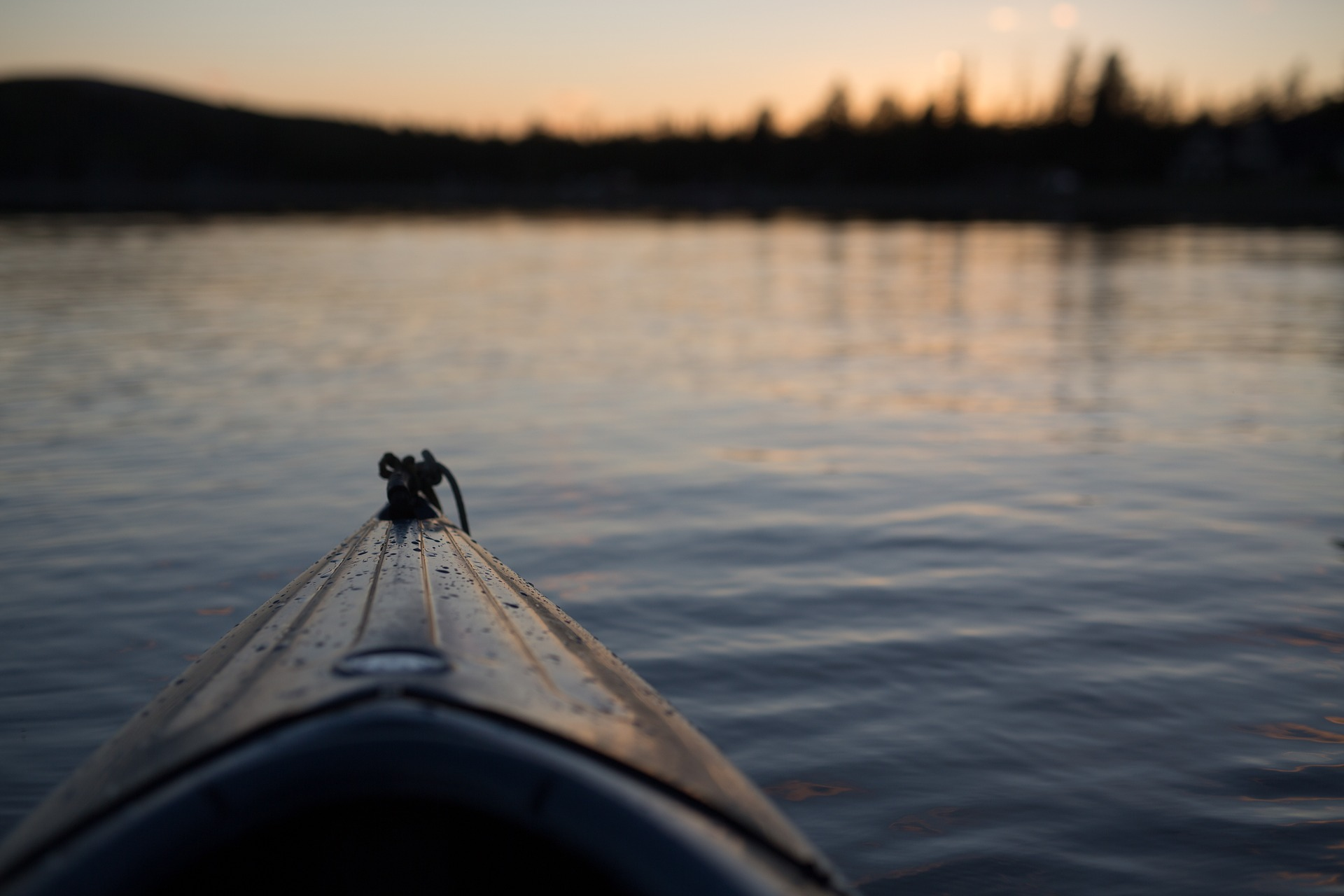 Front of canoe boat in water.