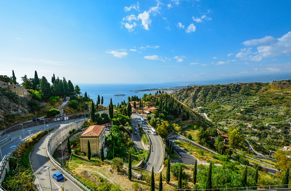 Winding roads on the hillside on a sunny day in Taormina, Sicily